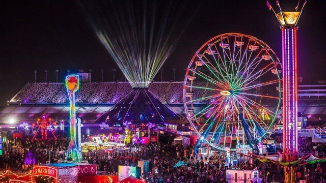 The Electric Daisy Carnival grounds were decorated with lit amusements and stages in the infield of the Las Vegas Motor Speedway on June 21, 2015. (Source: aLive Coverage for Insomniac)